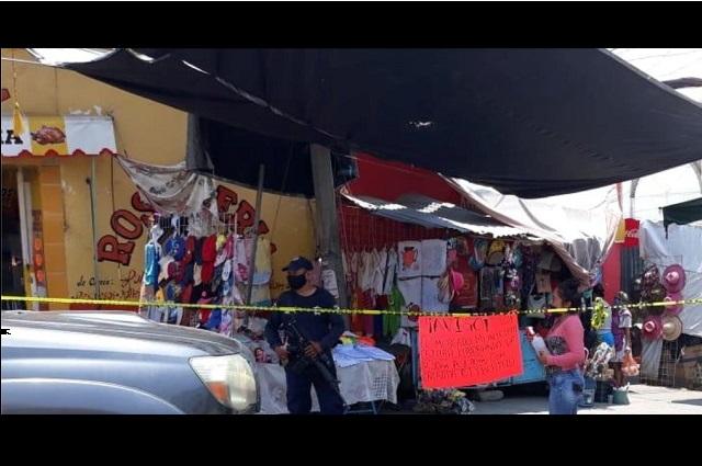 Restringen acceso a mercado municipal de Acatlán por Covid-19