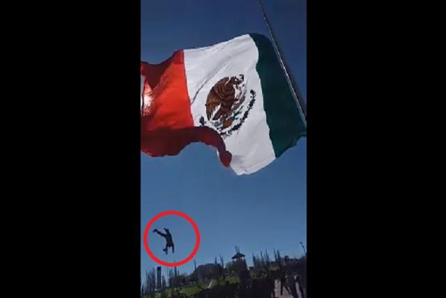 Soldado se enreda con enorme bandera y sale disparado