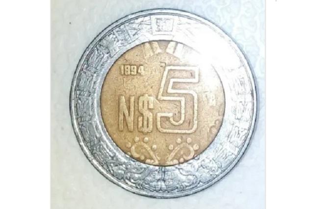 Venden moneda de 5 nuevos pesos en 23 mil pesos