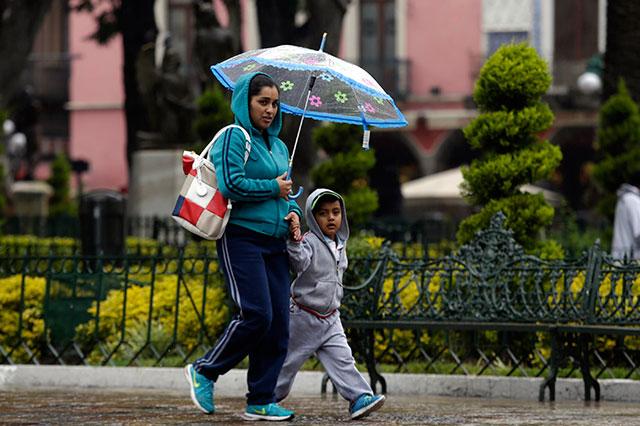 Por lluvias suspenden clases el jueves en 70 municipios poblanos