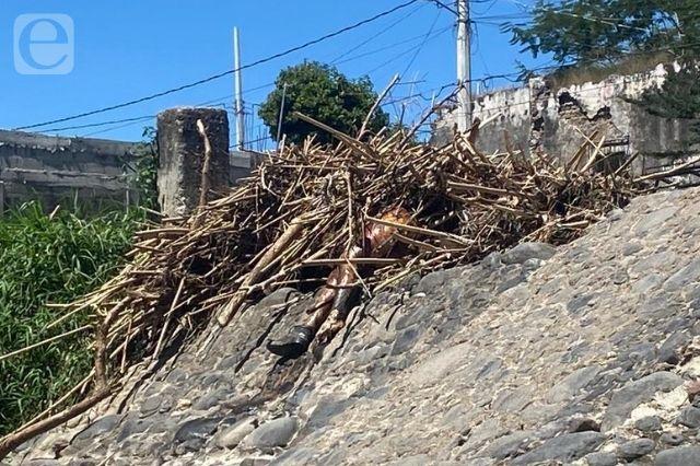 Hallan cadáver en estado descomposición en río Nexapa