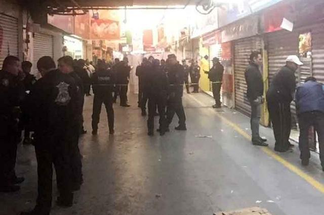 Difunden otro video del asesinato de la mujer policía en la Central de Abasto