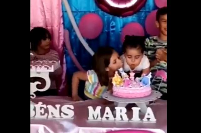 ¿De dónde es el video de la niña que sopla al pastel de su hermana?
