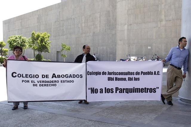 Se amparan abogados contra aumento en copias fotostáticas