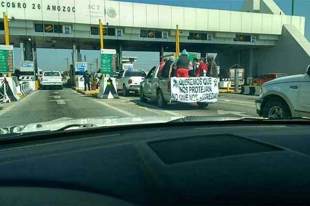 Pobladores de Palmarito llevan protesta contra Ejército a CDMX