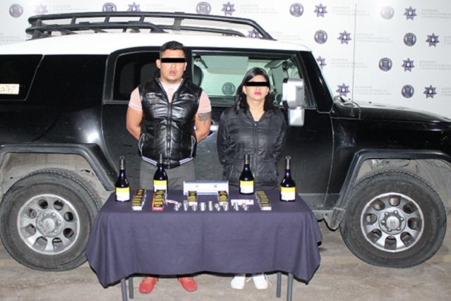 Cae pareja por robo a tienda Oxxo en San Bernabé Temoxtitla