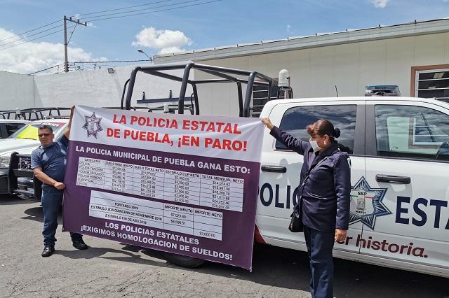 Cede gobierno y anuncia alza salarial de 2 dígitos a policías
