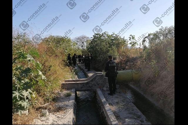 Hallan cadáver de adolescente en canal de riego de Tehuacán