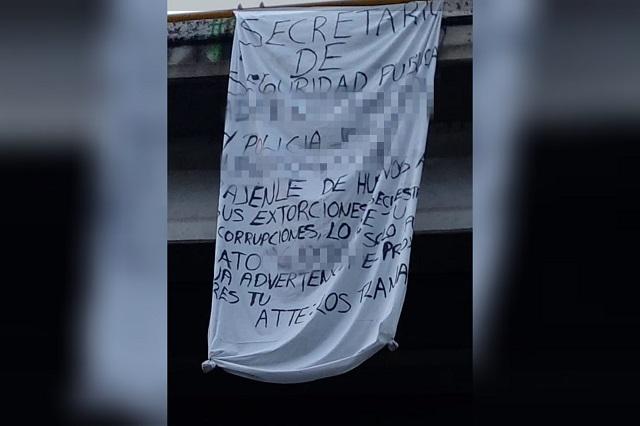 Con mantas en Texmelucan banda amenaza a mandos