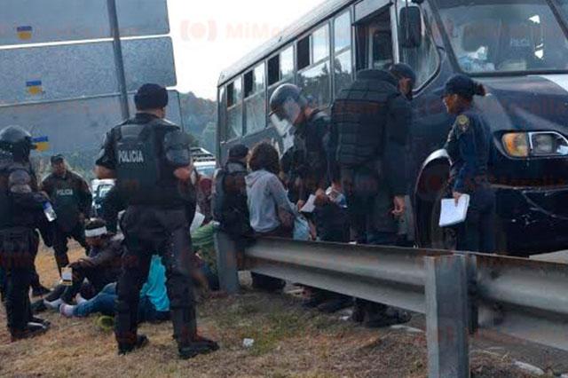 Ajustan a 92 la cifra de detenidos en Michoacán y 7 policías heridos