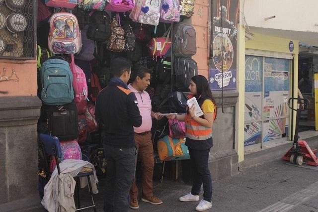 Orientan a comercios del centro de Puebla para regreso a clases