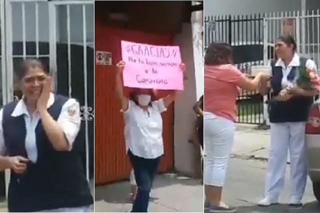 Entre aplausos y flores, vecinos reciben a enfermera en Jalisco