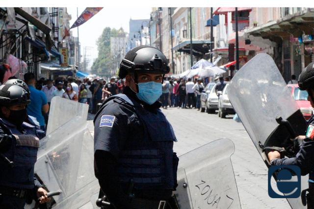 La IP condena violencia de ambulantes en centro de Puebla