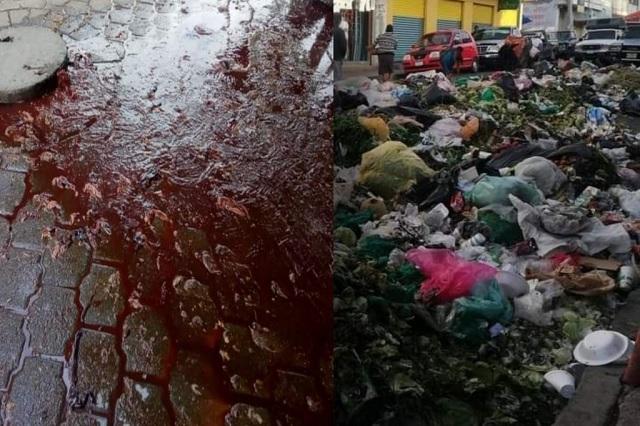 Lucen calles de Tehuacán basura y ríos de sangre