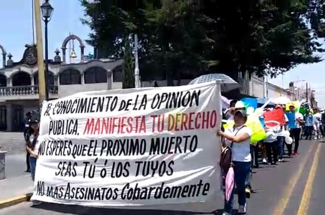 Marchan en El Seco en protesta por asesinato de dos hermanos
