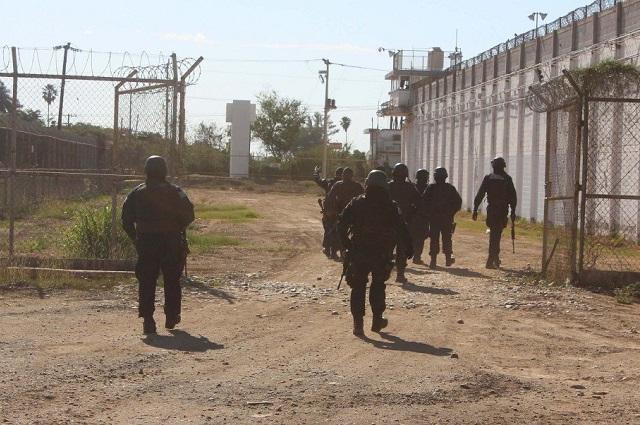 Durante balacera contra hijo de El Chapo, se fugan 30 reos en Sinaloa