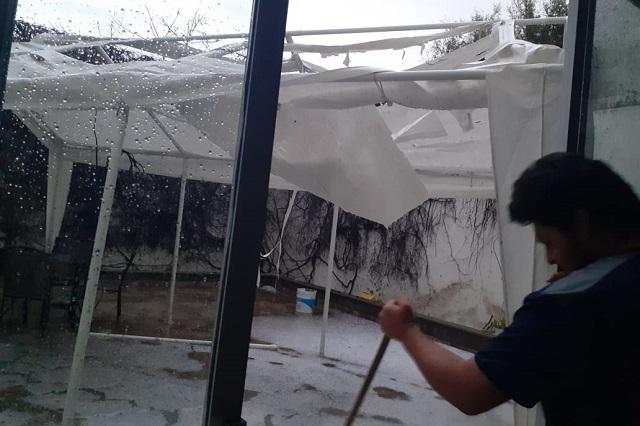 Lluvias y sismo dejan daños en 17 municipios poblanos