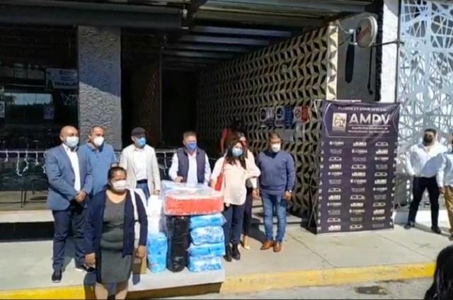 Empresarios textileros donan 100 mil cubrebocas en Tehuacán