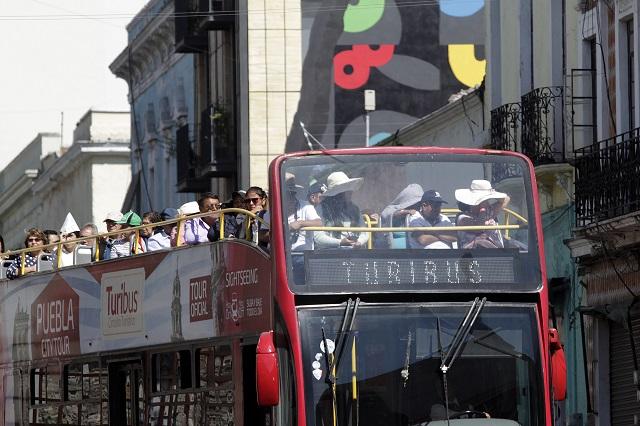 Molesta a hoteleros prohibición de aparcar camiones de turismo