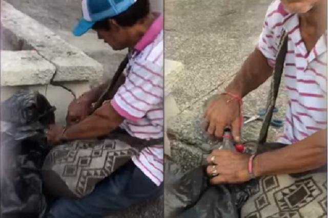 Video: Captan a vendedor rellenando botellas de Coca Cola que encontraba en la calle