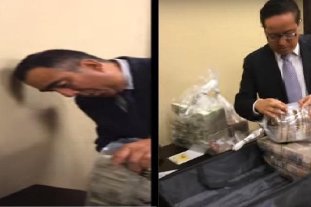 ¿Quiénes son los funcionarios que reciben fajos de billetes?