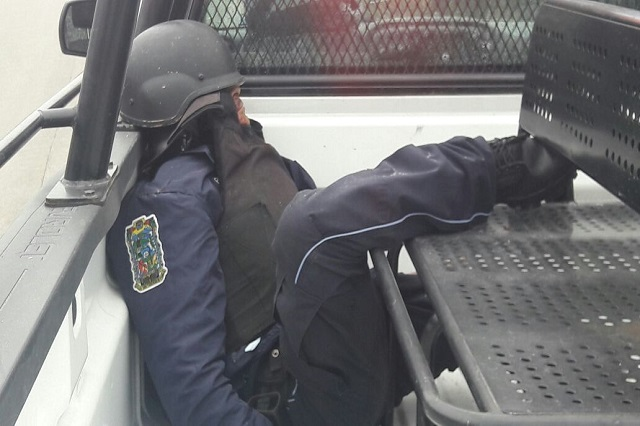 Acribillan a tres policías que llevaban dinero de Prospera